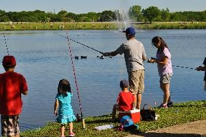 Families Participating in Kid Fish Event at Rheudasil Park