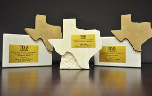 Three plaques in the shape of Texas, given as awards to the Flower Mound Parks and Recreation depart