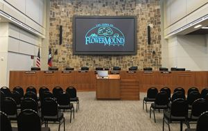 Flower Mound Council Chambers with TV in center