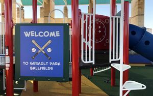close up of Gerault Park playground upgrades with a sign that says welcome to the gerault park ballf