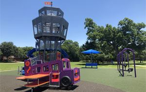 photo of Lakewood Playground upgrades that shows with a control tower, mini airplane and swingset