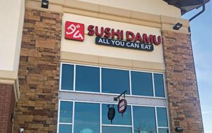 sign of the front of Sushi Damu in Flower Mound